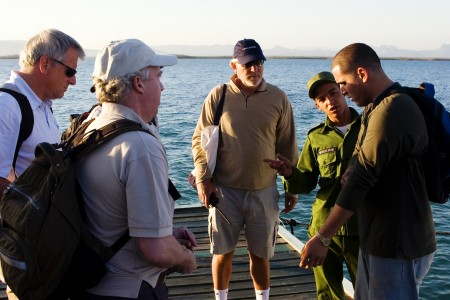 The boys confer with Eliaz on the Cayo Levisa dock. Photos by David Lansing.
