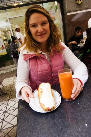 Liz with a completo (not healthy) and carrot juice (healthy!).