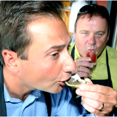 A customer samples oysters under the gaze of Liam Dolan, owner of the Olde Dublin Pub. Photo by Heather Taweel.