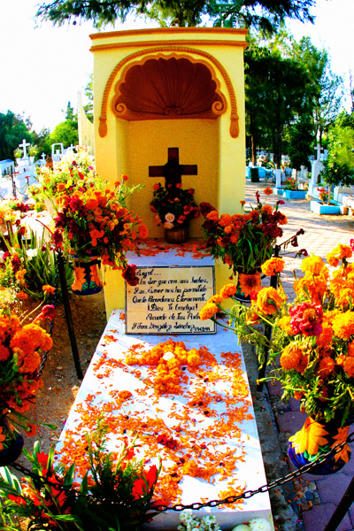 A decorated grave at the cemetery in San Miguel.