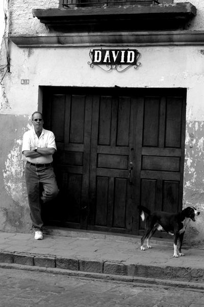 The author and a street dog in San Miguel. Photo by David Lansing.