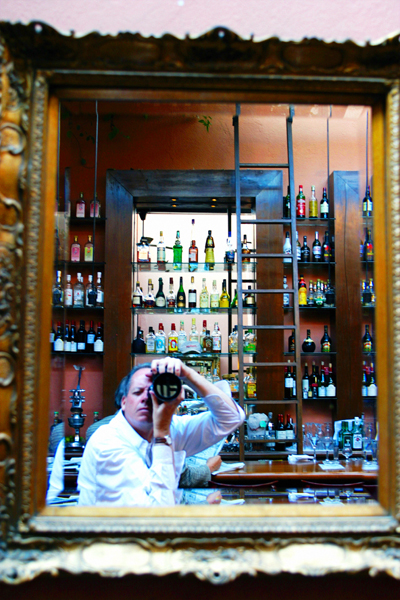 Self-portrait at Harry's bar in San Miguel. Photo by David Lansing.
