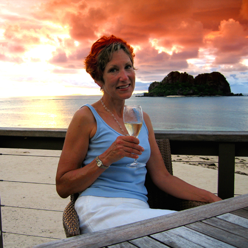 A pretty woman, champagne, and sunset at The Rock on Vomo Island--the perfect way to end the year. Photo by David Lansing.