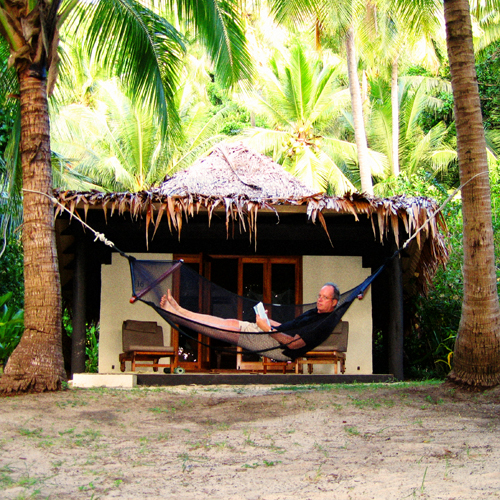 Is reading in a hammock suspended between coconut trees a wise thing? Photo by David Lansing.