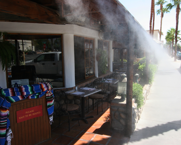 A fine mist blows over Armando's in Palm Desert. Photo by David Lansing.