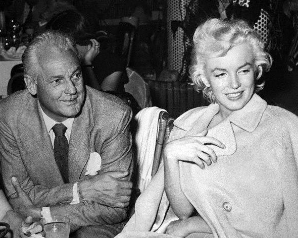 Charlie Farrell with Marilyn Monroe at the Racquet Club in Palm Springs.