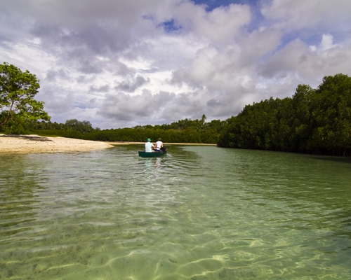 Storm clouds gather as we canoe to Malo's blue hole. Photo by David Lansing.