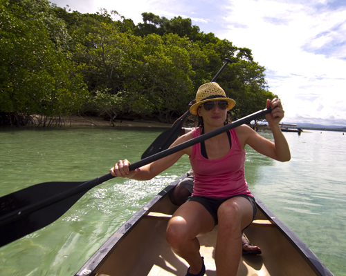 G paddling upriver to the blue hole on Malo Island. Photo by David Lansing.